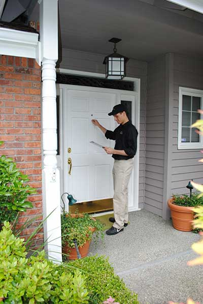 Pest Control Technician knocking on door